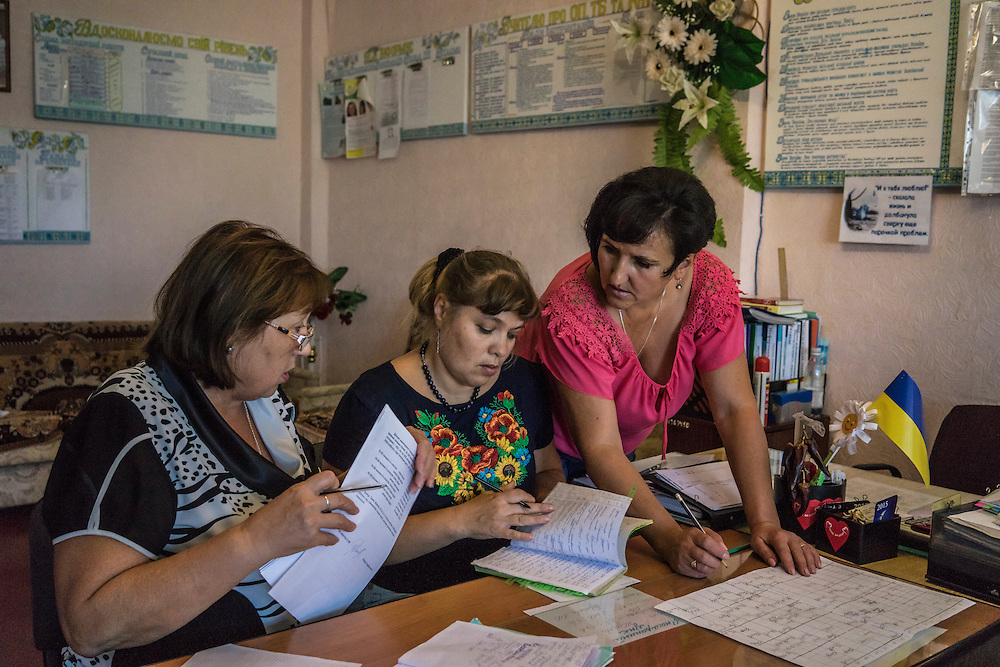 MARIUPOL, UKRAINE - AUGUST 31, 2015: Teachers prepare schedules for the first day of school at School 68 in Mariupol, Ukraine. A recent decrease in fighting has been credited to a desire to not interfere with the start of a new school year, planned for September 1. CREDIT: Brendan Hoffman for The New York Times