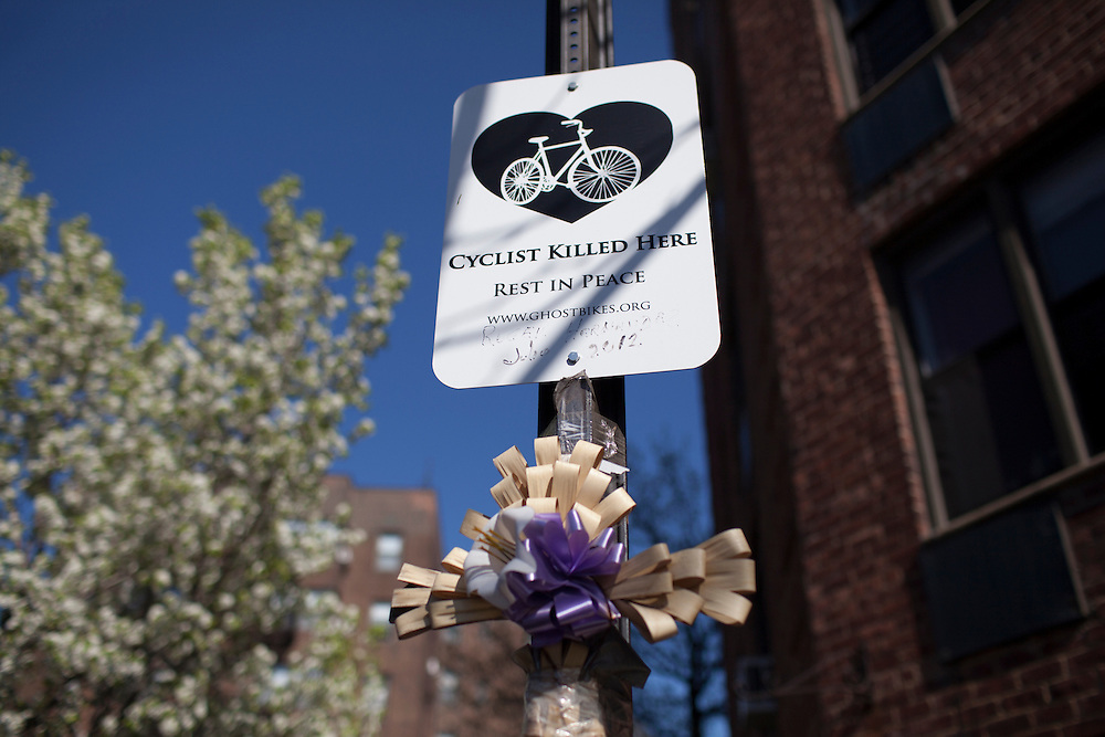 Families and friends of New Yorkers killed while bicycling on New York City streets gather at the Ghost Bike memorial for Roger Hernandez, at the corner of Greenpoint Ave. & 39th St. in Queens, NY, on Sunday, April 21, 2013 as they participate in the 8th Annual Ghost Bike Memorial Ride. The ride visited the 20 white-painted Ghost Bikes installed at the scene of bicyclist fatalities in five boroughs before converging at the intersection of Queens Boulevard and Jackson Avenue to dedicate a memorial to all of the cyclists who were killed in traffic crashes in 2012 whose deaths did not make the news...According to the New York City Department of Transportation, 136 pedestrians and 18 bicyclists were killed in 2012. In 2011, 134 pedestrians and 22 bicyclists were killed on New York City streets. To date, at least two bicyclists have been killed in 2013...Photograph by Andrew Hinderaker for the Ghost Bike Project.