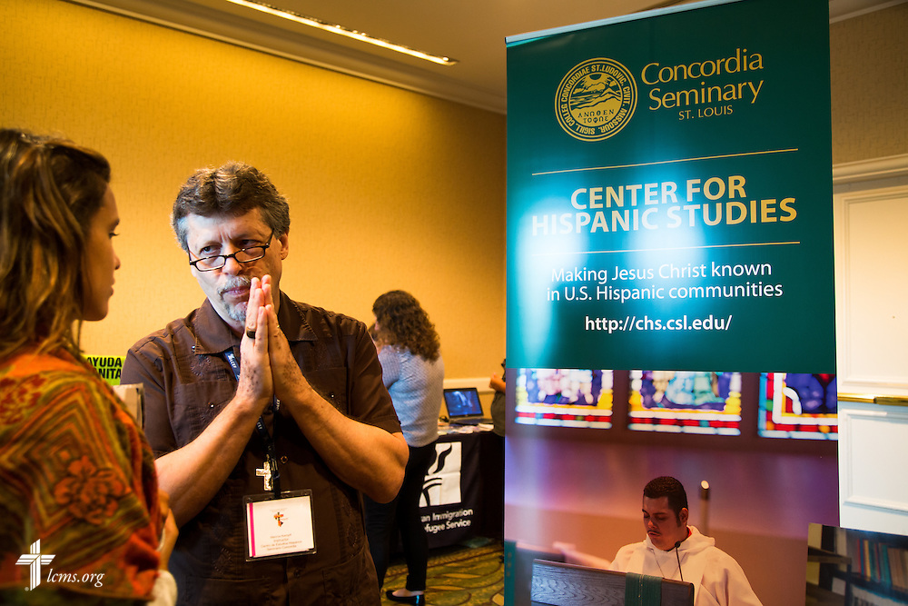 "Mark ""Marcos"" Kempff, an instructor at the Center for Hispanic Studies at Concordia Seminary, St. Louis, carries a conversation with a participant on Wednesday, July 29, 2015, during the 5th Hispanic National Convention, ""¡Come and See!: Celebrating Our Gifts,"" at the Grand Hyatt Tampa Bay in Tampa, Fla. LCMS Communications/Pamela Nielsen"