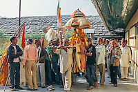 A Kullu deity enters the Raghunath temple to take blessings on Kullu Dussehra. Kullu Dussehra is the Dussehra festival observed in the month of October in Himachal Pradesh state in northern India. It is celebrated in the Dhalpur maidan in the Kullu valley. Dussehra at Kullu commences on the tenth day of the rising moon, i.e. on 'Vijay Dashmi' day itself and continues for seven days. Its history dates back to the 17th century when local King Jagat Singh installed an idol of Raghunath on his throne as a mark of penance. After this, god Raghunath was declared as the ruling deity of the Valley.