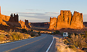 The orange sandstone Courthouse Towers resist erosion in Arches National Park, Utah, USA. These rock monuments are beautiful both at sunrise (seen here) and sunset. The Courthouse Towers are comprised of the Slick Rock member of Entrada Sandstone above the red-brown. or chocolate-brown marker beds of the Dewey .Bridge member. At left are the Three Gossips.