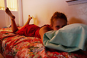 Melissa lays in bed in Oklahoma City, Oklahoma on June 19, 2006.