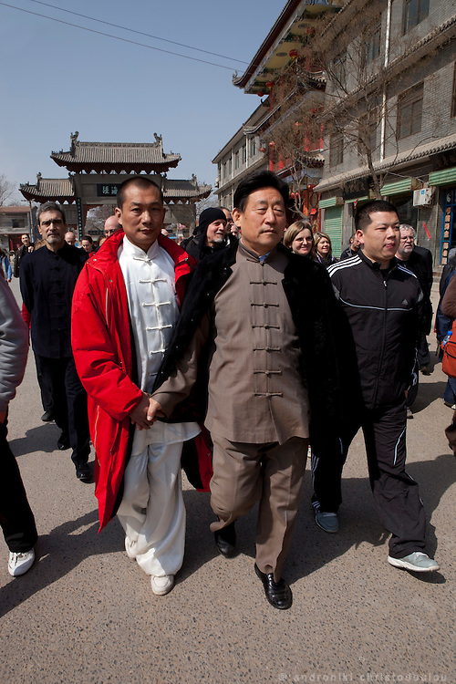 Grandmaster Chen Xiaowang guided by one of his students to the mausoleum of the founder of Taijiquan and 9th generation of Chen family Chen Wangting (1600-1680) where he will take part in a ceremony to accept a number of students as his official students and new members of the Chen family.