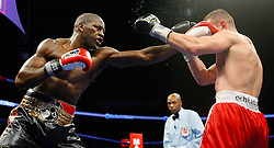Dec 11, 2008; Newark, NJ, USA; Tomasz Adamek (red/white) and Steve Cunningham (black/gold) trade punches during their 12 round bout at the Prudential Center. Adamek captured the belt via 12 round split decision.