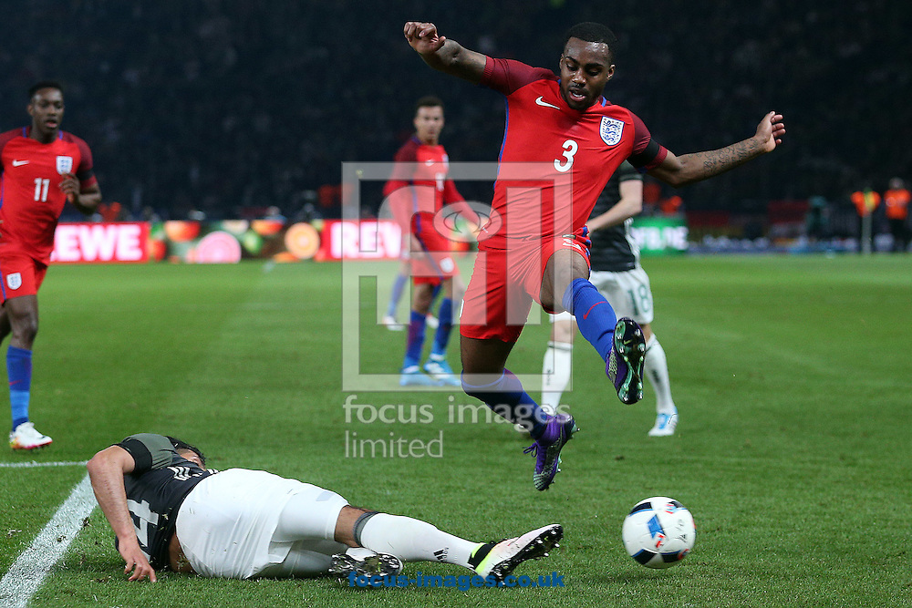 Danny Rose of England leaps a tackle by Emre Can of Germany during the International Friendly match at Olympiastadion Berlin, Charlottenburg-Wilmersdo<br /> Picture by Paul Chesterton/Focus Images Ltd +44 7904 640267<br /> 26/03/2016