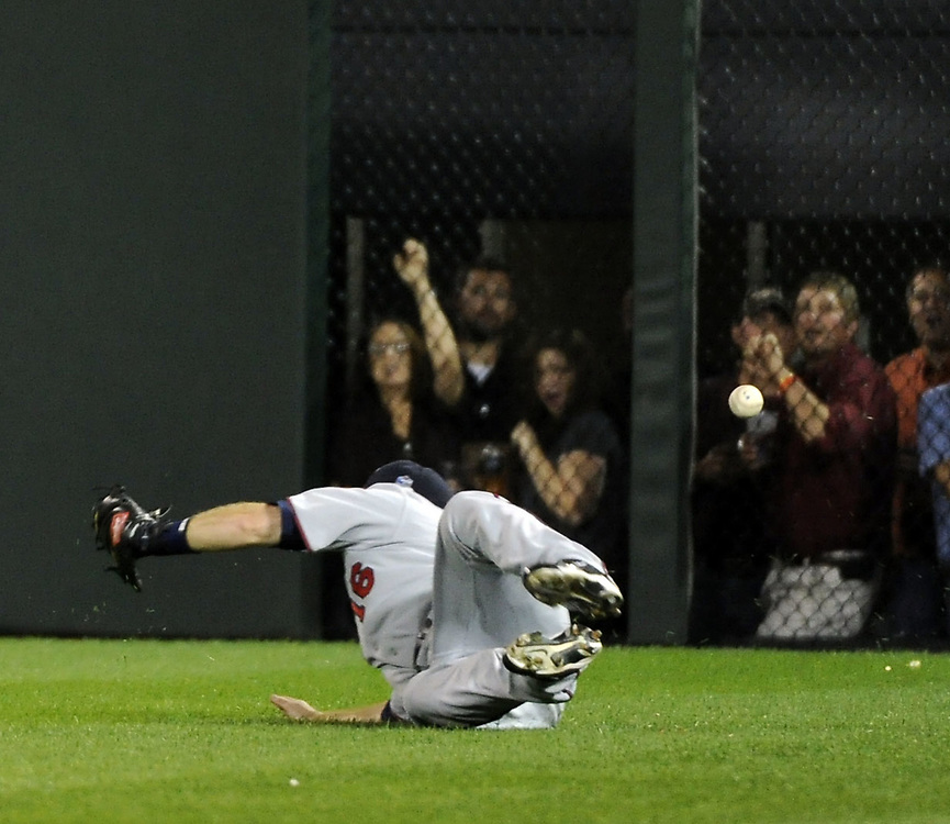 CHICAGO - SEPTEMBER 14:  Jason Kubel #16 of the Minnesota Twins dives but cannot catch the ball hit by Paul Konerko #14 of the Chicago White Sox for a triple on September 14, 2010 at U.S. Cellular Field in Chicago, Illinois.  The Twins defeated the White Sox 9-3.  (Photo by Ron Vesely)