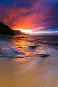 Sunset over the Na Pali Coast from Hideaways Beach, Princeville, Kauai, Hawaii USA