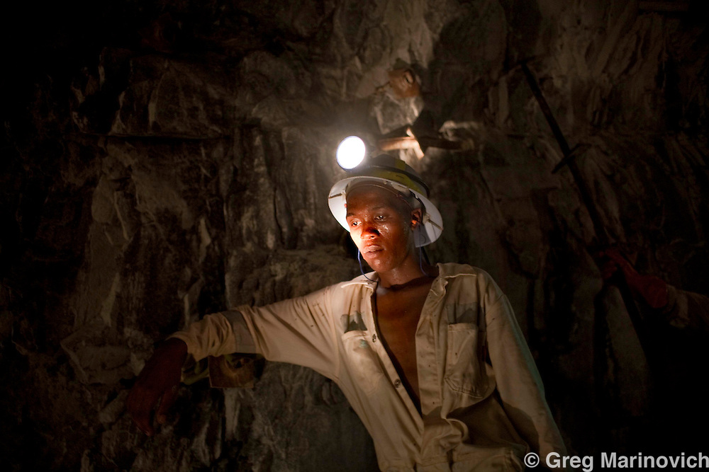 A miner rests at the rockface where AngloGoldAshanti broke the record and reached deeper into the earth than any other mine previously, with the Mponeng gold mine descending to 3778 meters below the surface Feb 3, 2009. Photo Greg Marinovich