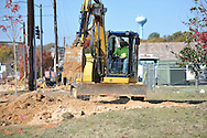 Workers upgrade a sewer line alongside University Avenue near the Highway 7 overpass in Oxford, Miss. on Thursday, November 8, 2012.