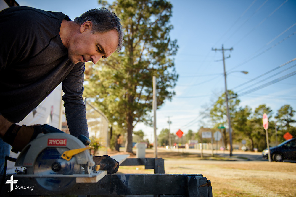 The Rev. Wayne Puls, senior pastor at Hope Lutheran Church, Wake Forest, N.C., saws wood for a wall at  Nanny's Korner Care Center on Thursday, Jan. 19, 2017, in Lumberton, N.C. The center was damaged in October from flooding related to Hurricane Matthew. Members of Hope are part of several congregations rebuilding the daycare. LCMS Communications/Erik M. Lunsford