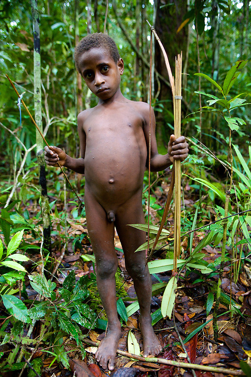 This boy has just shot a tiny lizard with his bow and arrow, they are deadly accurate from a very young age. West Papua is home to over 300 tribes. They have inhabited the island for more than 40,000 years. Many of the last remaining tribal cultures on our planet can be found in West Papua. An astounding 15% of the world's languages are spoken there, by just 0.01% of the global population.