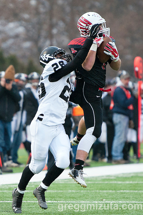 Santiam Christian's Tanner Macal intercepts a Cade Perry pass intended for Rudy Gomez late in the second quarter of the 3A Championship game at Kennison Field, Hermiston, Oregon, Saturday, November 28, 2015. Vale won 27-20.