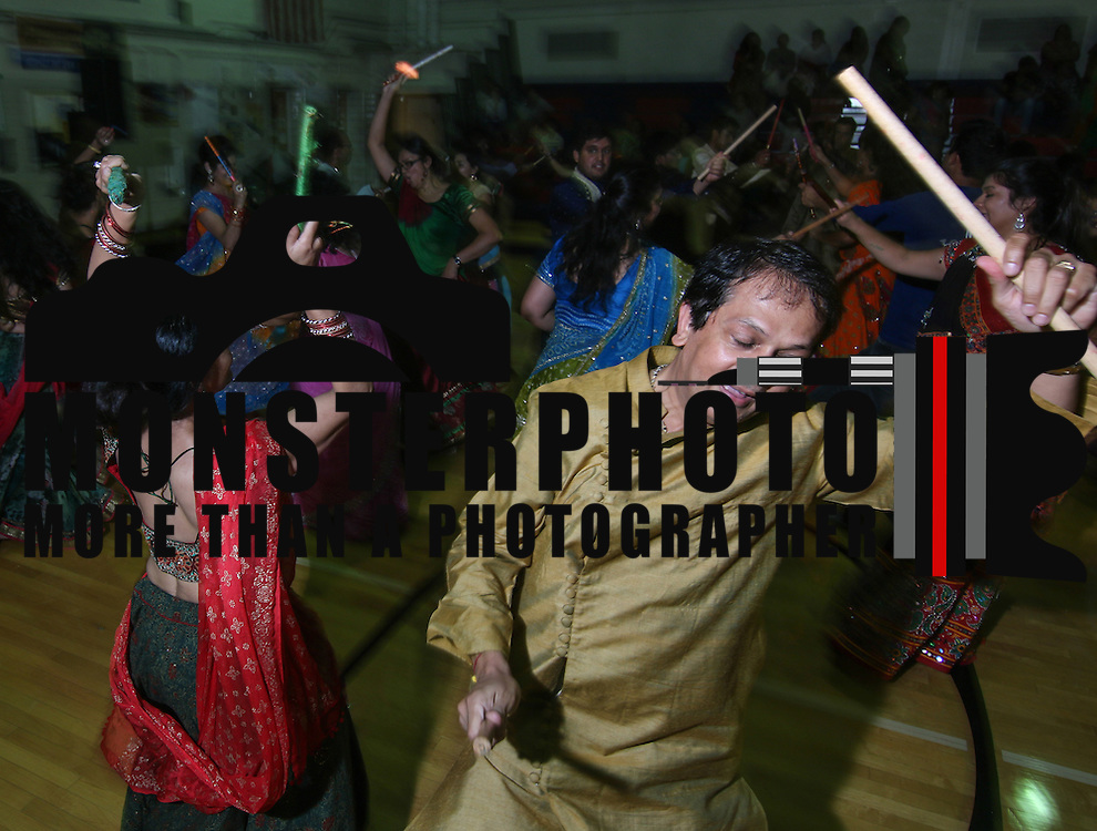 Dr. Ashish Parikh (RIGHT) and Dr. Mona Parikh (LEFT) participate in a Navrati (Ras Garba) dance Friday, Oct 3, 2014 at Christiana High School in Newark, Del.
