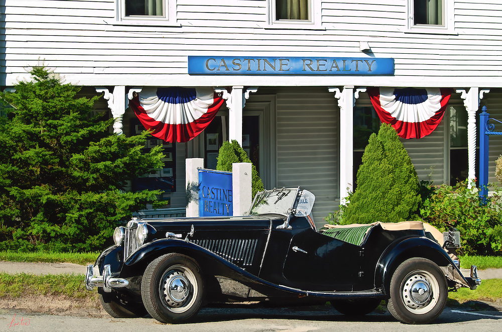 Classic MG outside of Castine, Maine real estate office around the 4th of July.