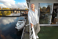 Steve Linton of Ultradesign who runs Spamhaus (the leading organization fighting junk e-mail), from his boat house, The Phoenix, at Taggs Island on the River Thames just outside London..Photo©Steve Forrest