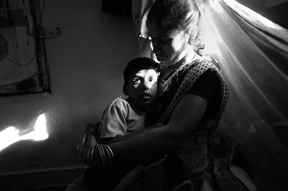 Rajini, 25, was ostracized from her husband's family after both her children were born with disabilities. Rajni comes from a small village many miles from Bhopal, however, 8-years-ago she married Navneet and as is Indian custom, moved into his parents' house in the water-contaminated colony of Shivshakti Nagar near Union Carbide's solar evaporation ponds. These ponds were the company's dumping ground for all their toxic waste. Rajni's in-laws blame her for their disabled grandchildren and say she has brought bad luck into their family.