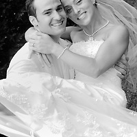 Groom holding bride in his arms.