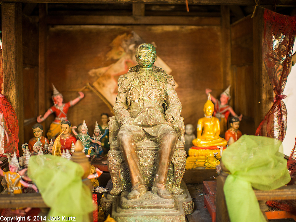 09 DECEMBER 2014 - THONBURI, BANGKOK, THAILAND: A spirit house in the market in Thonburi section of Bangkok. The spirit house honors King Chulalongkorn, one of the most revered monarchs of the Chakri dynasty. Spirit houses are found in most homes and public buildings in Thailand and Cambodia.     PHOTO BY JACK KURTZ