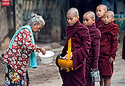 Novices collecting alms in Mandalay, Myanmar.