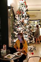 Woman using laptop in a café in Sharm-el-Sheik, Christmas
