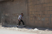 A Free Syrian Army fighter with an rocket propelled grenade launcher (RPG) during a attack on government  forces  in Karm al-Tarib, near Aleppo's international airport.Aleppo, Syria August 17,2012. (Photo by Heidi Levine/Sipa Press).