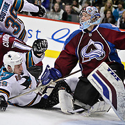 SHOT 4/4/10 7:12:20 PM - Colorado Avalanche goaltender Craig Anderson (#41) looks to avoid a collision with the San Jose Sharks'  Ryane Clowe (#29) and Logan Couture (#39) as well as teammate Kyle Cumiskey (#10) in the goal crease during the second period of their NHL regular season game at the Pepsi Center in Denver, Co. The Avalanche won the game 5-4 in overtime ending a four game losing streak and helping themselves in the race for the final playoff spot in the Western Conference. (Photo by Marc Piscotty / © 2010)