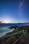 The southern Milky Way and the Southern Cross rising in the southeast as the Moon begins to rise and light the sky at left. Above Crux is the Carina Nebula; below Crux are the Pointer Stars. <br /> <br /> The location is the Captain Cook Lookout at Nambucca Heads on the Mid North Coast of NSW, Australia. The beach below is Shelly Beach.<br /> <br /> This is a single 30-second exposure at ISO 3200 on the Canon 6D, and with the 14mm Rokinon lens at f/4.