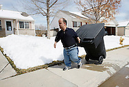 Chris Kotzian brings in a trash can outside his home in Thornton, Colorado March 25, 2010.  Chris is a achondroplasia dwarf.  Preferring to be called a little person Chris is active in the Little People of America, the only dwarfism support organization that includes all 200+ forms of dwarfism.  REUTERS/Rick Wilking (UNITED STATES)