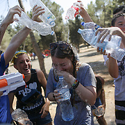 Israelis spray water at each other during a fun water fight event in Sacher Park during a hot summer day in Jerusalem. August 09, 2013.August 09, 2013. Photo by Oren Nahshon