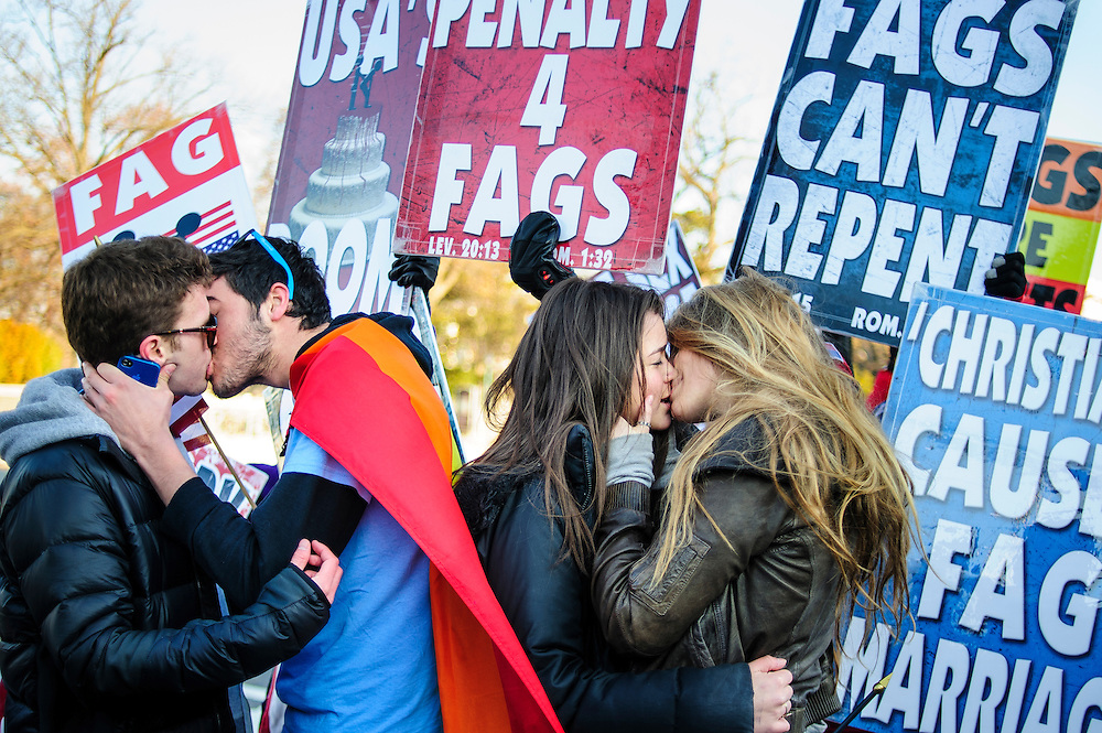 Georgetown University students Dillon Brooks, 19 and Tim Devita 21 and Hannah Hauer-King 21, and Alexandra Waldon, 20, kiss in front of the Westboro Baptist Church protesters at the Supreme Court in Washington D.C. Activists on both sides of the same sex marriage issue rallied outside of the Court in Washington, D.C. as the Court is to hear arguments on the constitutionality  the 1996 Defense of Marriage Act (DOMA) DOMA defines marriage as only between a man and a woman.