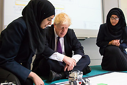 Camden City Learning Centre, London, June 15th 2015. London Mayor Boris Johnson joins future entrepreneurs at Camden City Learning Centre to launch London Technology Week and to launch a dedicated online hub for the Capital's thriving technology industry. PICTURED: The Mayor watches as students demonstrate the robots that they have programmed.