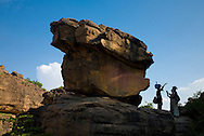 Tourists listening to guides explanation on the rocky formations in the Bandiagara Escarpment near Dourou village. The Dogon Country is the most visited part of Mali with tourists visiting its tipical  villages that can be located on the cliff, on the sandy plain or in the rocky plateau