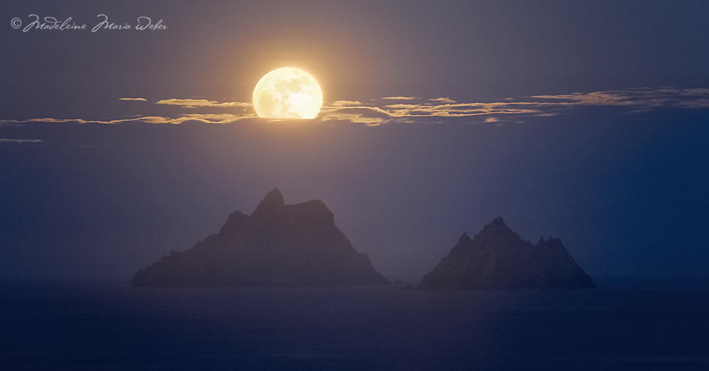 Full Moon setting behind Skellig Michael and Little Skellig, County Kerry, Ireland ****** <br /> <br /> Visit &amp; browse through my Photography &amp; Art Gallery, located on the Wild Atlantic Way &amp; Skellig Ring between Waterville and Ballinskelligs (Skellig Coast R567), only 3 minutes from the main Ring of Kerry road.<br /> https://goo.gl/maps/syg6bd3KQtw<br /> <br /> ******<br /> <br /> Contact: 085 7803273 from an Irish mobile phone or +353 85 7803273 from an international mobile phone
