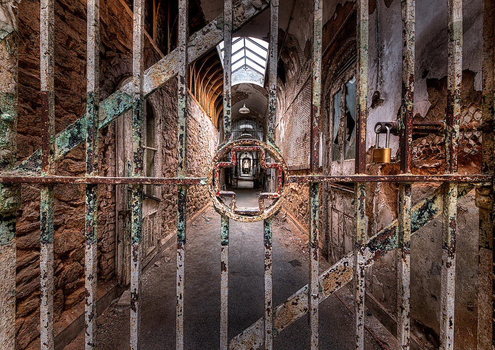 A cross adorns a metal gate to the medical ward inside Eastern State Penitentiary in Philadelphia, PA