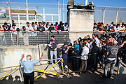 Syrian refugees queue to receive food tokens from the UNHCR, in the southern city of Saida, Lebanon. The official number of Syrian refugees in Lebanon is now 520,000, representing almost 25% of the local population. Tension has risen as the influx has put pressure on the education and health systems, as well as natural resources and employment.