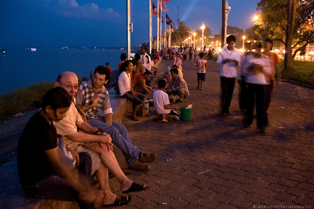 French guy (left) with a young prostitute, siting at the riverfront of Phnom Penh. The riverfront if a place where many Cambodians go for an evening out but also prostitutes look for customers and vice-versa.
