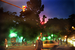 BUENOS AIRES, ARGENTINA:  Locals walk the streets at dusk in Buenos Aires, Argentia. (Photo by Ami Vitale)
