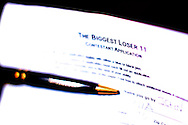 """The application for contestants for season 11 of """"The Biggest Loser"""" television show is shown in Broomfield, Colorado July 17, 2010. Over 600 people attended, some spending the night on the sidewalk outside the hall for a chance to be on the show and win $250,000. REUTERS/Rick Wilking (UNITED STATES)"""