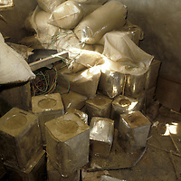 Bags and tins of kif powder stand ready for processing into hashish in the Bekaa Velley of Lebanon.