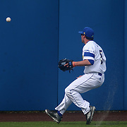 Delaware Outfielder Mike Krusinski (5) attempts to field the ball in left field during a regular season baseball game between Delaware and Saint Joseph's at Bob Hannah Stadium Tuesday April 19, 2016, in Newark.