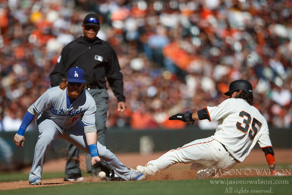 SAN FRANCISCO, CA - OCTOBER 02: Brandon Crawford #35 of the San Francisco Giants steals third base ahead of a tag from Justin Turner #10 of the Los Angeles Dodgers during the seventh inning at AT&T Park on October 2, 2016 in San Francisco, California. The San Francisco Giants defeated the Los Angeles Dodgers 7-1. (Photo by Jason O. Watson/Getty Images) *** Local Caption *** Brandon Crawford; Justin Turner