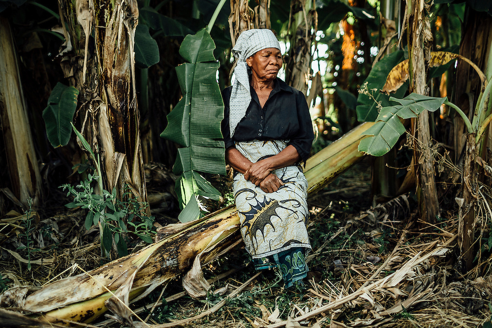 """Emily Towuni, 75, Southern Region, Malawi. """"I lost my maize.""""  The land which was originally her parents field was flooded in January of 2015. Up until that point there have been floods but nothing as serious and when they came in 2015, Emily lost all of her crops including maize, pumpkins and beans. She is now in a position where she is relying on neighbours to find her work in return for money or food."""
