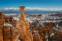 Thor's Hammer stands tall over the canyon hoodoos seen from the Navajo Loop trail in Bryce Canyon National Park on a sunny Winter day.