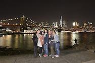Friends in Brooklyn Bridge Park on East River.