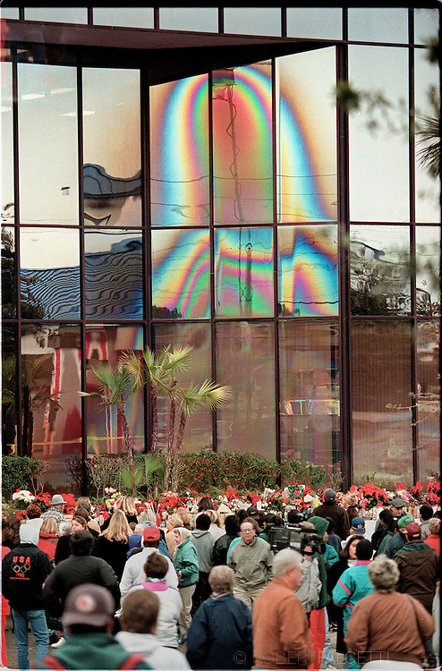 CLEARWATER, FLORIDA: A likeness of the Virgin Mary appears on the windows of the Ugly Duckling car rental business on U.S. 19 in Clearwater in December 1996. Since that time millions of people have visited the site. In 2004, a teenager used steel balls to destroy the windows. (Photo by Robert Falcetti). .