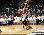 "Mississippi's Ladarius White (10) dribbles around Arkansas Little Rock's Ben Dillard (24) at the C.M. ""Tad"" Smith Coliseum in Oxford, Miss. on Friday, November 16, 2012."