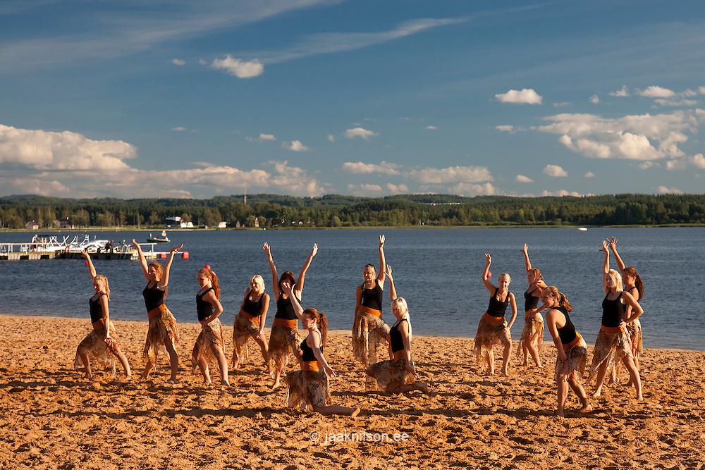Teenage Girls Dancing on Beach, Lake Tamula in Võru, Estonia