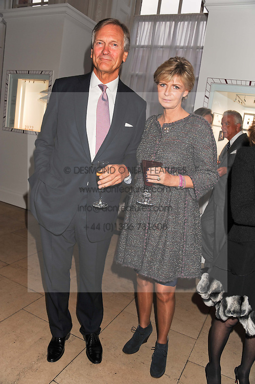 CHARLES & PANDORA DELEVINGNE at a reception to present the new Cartier Tank Watch Collection held at The Orangery, Kensington Palace Gardens, London W8 on 19th April 2012.