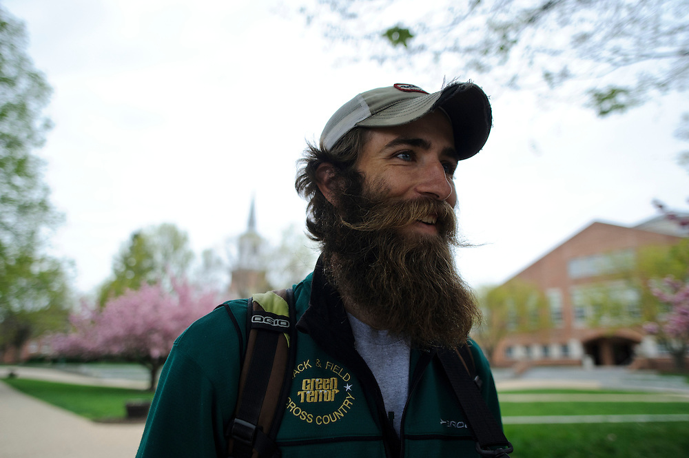 photo by Matt Roth.Wednesday, April 11, 2012..After finishing his exercise science exam, Ron Shriver walks McDaniel College's campus in Westminster, Maryland Wednesday morning, April 11, 2012, to get breakfast at The Pub, an on-campus eatery.. .Ron Shriver is a retired marine staff sergeant. He is also the first in his family to attend college, thanks to the New G.I. Bill. His wife, a fellow retired Marine, is finishing up graduate school in Alaska. After Ron gets his undergraduate degree from McDaniel College in May, he plans to drive to Alaska with is two children Rory, 6, and Miles, 5. For the move Ron got rid of most of his family's belongings, and after his lease was up, he and his children moved back into his parent's farmhouse.