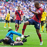 Jamaica Keeper Donovan Ricketts #1(bottom) makes a sliding save as Attacker Juan Agudelo #9 try to score in the second half. The United State would go on to to defeat Jamaica 2-0 in the concacaf gold cup quarterfinals Sunday, June 19, 2011 at  RFK Stadium in Washington DC.